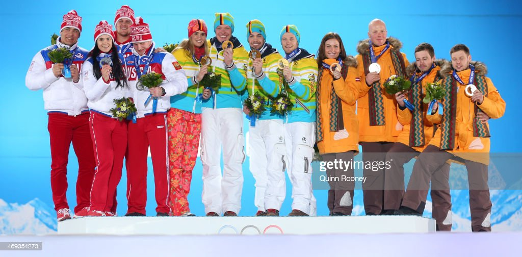 Silver medalists Russia, gold medalists Germany and bronze medalists Latvia celebrate on the podium during the medal ceremony for the Luge Team Relay on day 7 of the Sochi 2014 Winter Olympics at Medals Plaza on February 14, 2014 in Sochi, Russia.