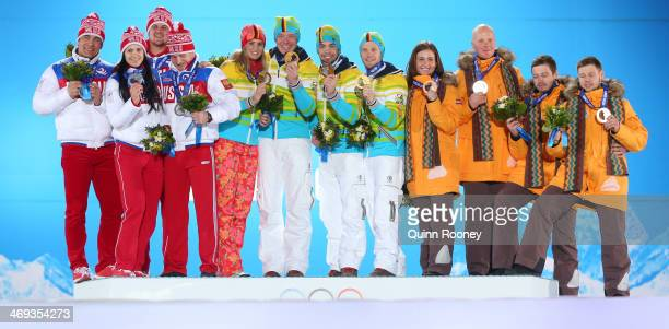 Silver medalists Russia gold medalists Germany and bronze medalists Latvia celebrate on the podium during the medal ceremony for the Luge Team Relay...