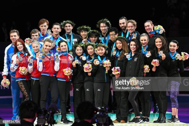 Silver medalists Russia gold medalists Japan and bronze medalists United States pose on the podium at the medal ceremony during day three of the ISU...