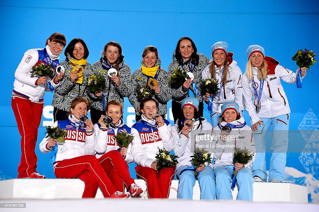 Silver medalists Russia, gold medalists Ukraine and bronze medalists Norway celebrate during the medal ceremony for the Biathlon Women's 4 x 6 km Relay on Day 15 of the Sochi 2014 Winter Olympics at Medals Plaza on February 22, 2014 in Sochi, Russia.