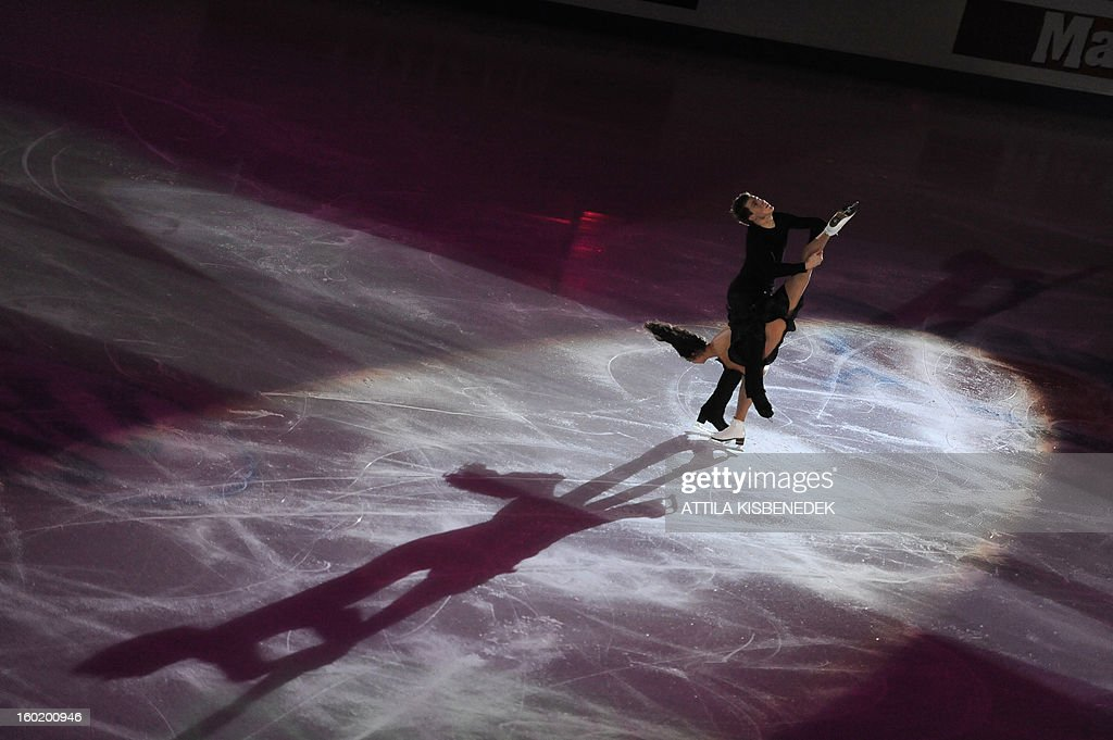 Silver medalists Russians Elena Ilinykh and Nikita Katsalopov perform on ice of 'Dom Sportova' sports hall in Zagreb on January 27, 2013 during the gala of the ISU European Figure Skating Championships. AFP PHOTO / ATTILA KISBENEDEK