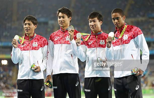 Silver medalists Ryota Yamagata Iizuka Shota Yoshihide Kiryu and Aska Cambridge of Japan stand on the podium during the medal ceremony for the Men's...