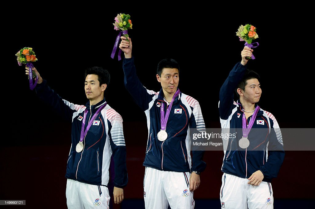Silver medalists Saehyuk Joo, Sang Eun Oh, and Seungmin Ryu of Korea celebrate on the poidum during the medal ceremony for the Men's Team Table Tennis on Day 12 of the London 2012 Olympic Games at ExCeL on August 8, 2012 in London, England.