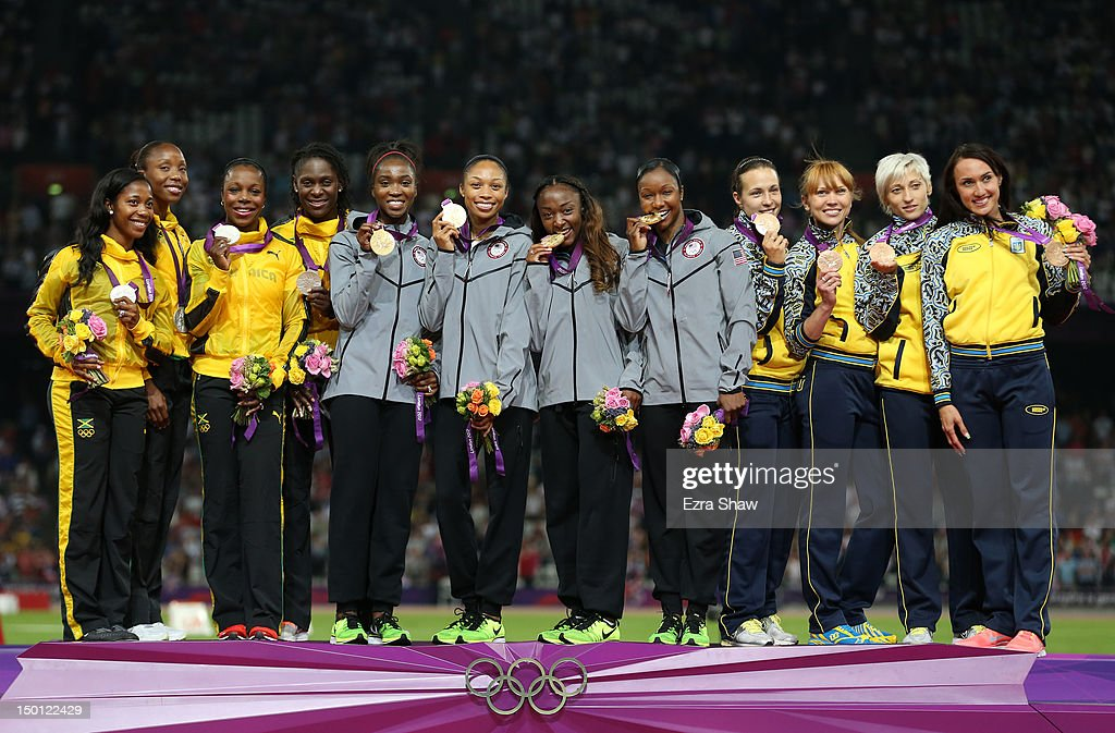 Silver medalists Shelly-Ann Fraser-Pryce, <a gi-track='captionPersonalityLinkClicked' href=/galleries/search?phrase=Sherone+Simpson&family=editorial&specificpeople=730166 ng-click='$event.stopPropagation()'>Sherone Simpson</a>, <a gi-track='captionPersonalityLinkClicked' href=/galleries/search?phrase=Veronica+Campbell-Brown&family=editorial&specificpeople=4861760 ng-click='$event.stopPropagation()'>Veronica Campbell-Brown</a> and Kerron Stewart of Jamaica, Gold medalists <a gi-track='captionPersonalityLinkClicked' href=/galleries/search?phrase=Tianna+Madison&family=editorial&specificpeople=204429 ng-click='$event.stopPropagation()'>Tianna Madison</a>, <a gi-track='captionPersonalityLinkClicked' href=/galleries/search?phrase=Allyson+Felix&family=editorial&specificpeople=213459 ng-click='$event.stopPropagation()'>Allyson Felix</a>, <a gi-track='captionPersonalityLinkClicked' href=/galleries/search?phrase=Bianca+Knight&family=editorial&specificpeople=2309997 ng-click='$event.stopPropagation()'>Bianca Knight</a> and <a gi-track='captionPersonalityLinkClicked' href=/galleries/search?phrase=Carmelita+Jeter&family=editorial&specificpeople=4472760 ng-click='$event.stopPropagation()'>Carmelita Jeter</a> of the United States and Bronze medalists <a gi-track='captionPersonalityLinkClicked' href=/galleries/search?phrase=Olesya+Povh&family=editorial&specificpeople=7119125 ng-click='$event.stopPropagation()'>Olesya Povh</a>, Hrystyna Stuym, Mariya Ryemyen and Elyzaveta Bryzgina of Ukraine pose on the podium during the medal ceremony for the Women's 4 x 100m Relay on Day 14 of the London 2012 Olympic Games at Olympic Stadium on August 10, 2012 in London, England.