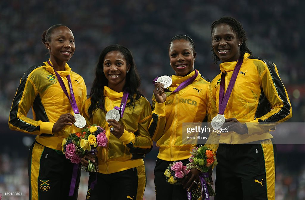Silver medalists <a gi-track='captionPersonalityLinkClicked' href=/galleries/search?phrase=Shelly-Ann+Fraser&family=editorial&specificpeople=5493833 ng-click='$event.stopPropagation()'>Shelly-Ann Fraser</a>-Pryce, <a gi-track='captionPersonalityLinkClicked' href=/galleries/search?phrase=Sherone+Simpson&family=editorial&specificpeople=730166 ng-click='$event.stopPropagation()'>Sherone Simpson</a>, <a gi-track='captionPersonalityLinkClicked' href=/galleries/search?phrase=Veronica+Campbell-Brown&family=editorial&specificpeople=4861760 ng-click='$event.stopPropagation()'>Veronica Campbell-Brown</a> and <a gi-track='captionPersonalityLinkClicked' href=/galleries/search?phrase=Kerron+Stewart&family=editorial&specificpeople=4472786 ng-click='$event.stopPropagation()'>Kerron Stewart</a> of Jamaica pose on the podium during the medal ceremony for the Women's 4 x 100m Relay on Day 14 of the London 2012 Olympic Games at Olympic Stadium on August 10, 2012 in London, England.