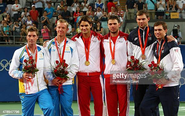 Silver Medalists Simon Aspelin and Thomas Johansson of Sweden Gold Medalists Roger Federer and Stanislas Wawrinka of Switzerland and Bronze Medalists...