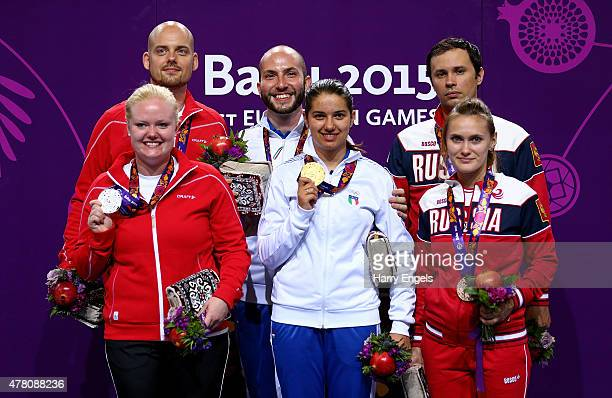 Silver medalists Steffen Olsen and Stine Nielsen of Denmark gold medalists Niccolo Campriani and Petra Zublasing of Italy and bronze medalists Sergey...