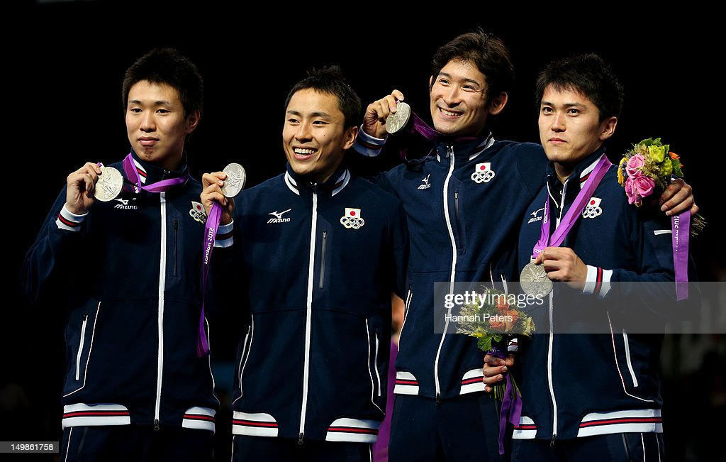 Silver medalists Suguru Awaji, <a gi-track='captionPersonalityLinkClicked' href=/galleries/search?phrase=Yuki+Ota&family=editorial&specificpeople=2956051 ng-click='$event.stopPropagation()'>Yuki Ota</a>, <a gi-track='captionPersonalityLinkClicked' href=/galleries/search?phrase=Ryo+Miyake&family=editorial&specificpeople=7462494 ng-click='$event.stopPropagation()'>Ryo Miyake</a> and <a gi-track='captionPersonalityLinkClicked' href=/galleries/search?phrase=Kenta+Chida&family=editorial&specificpeople=4073098 ng-click='$event.stopPropagation()'>Kenta Chida</a> of Japan celebrate on the podium during the medal ceremony after the Men's Foil Team Fencing finals on Day 9 of the London 2012 Olympic Games at ExCeL on August 5, 2012 in London, England.