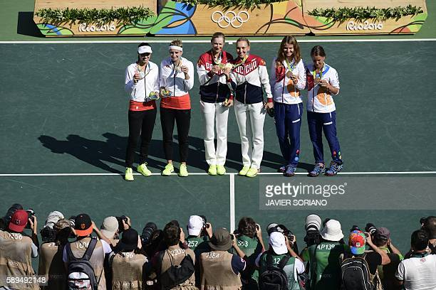 Silver medalists Switzerland's Timea Bacsinszky and Switzerland's Martina Hingis gold medalists Russia's Ekaterina Makarova and Russia's Elena...