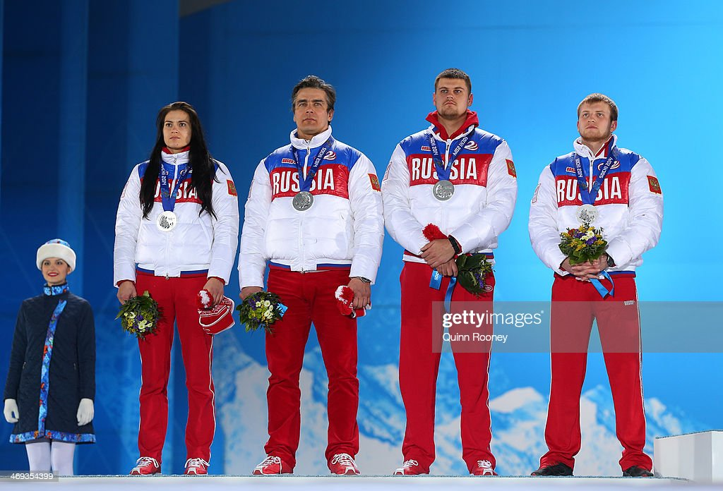 Silver medalists Tatyana Ivanova, Albert Demchenko, <a gi-track='captionPersonalityLinkClicked' href=/galleries/search?phrase=Alexander+Denisyev&family=editorial&specificpeople=12466169 ng-click='$event.stopPropagation()'>Alexander Denisyev</a> and <a gi-track='captionPersonalityLinkClicked' href=/galleries/search?phrase=Vladislav+Antonov&family=editorial&specificpeople=8891668 ng-click='$event.stopPropagation()'>Vladislav Antonov</a> of Russia celebrate on the podium during the medal for the Luge Team Relay on day 7 of the Sochi 2014 Winter Olympics at Medals Plaza on February 14, 2014 in Sochi, Russia.
