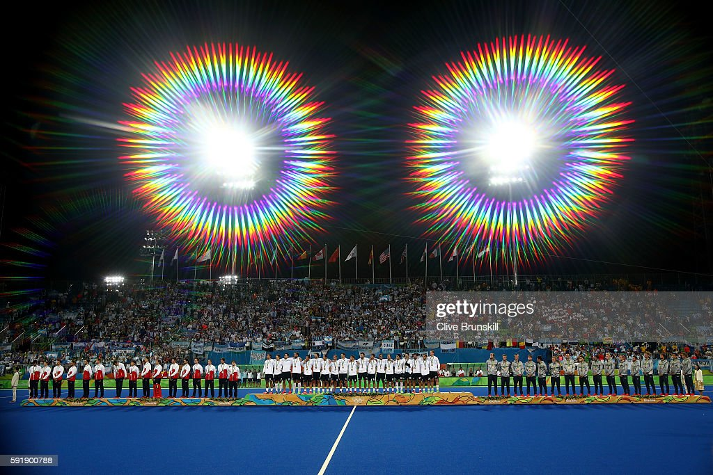 Silver medalists Team Belgium gold medalists Team Argentina and bronze medalists Team Germany pose on the podium during the medal ceremony for the...
