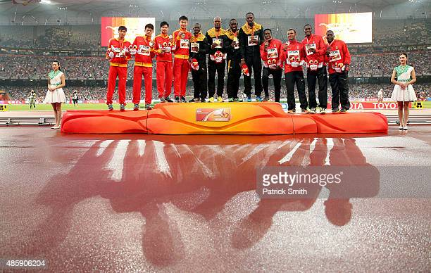 Silver medalists Team China gold medalists Team Jamaica and bronze medalists Team Canada pose on the podium during the medal ceremony for the Men's...