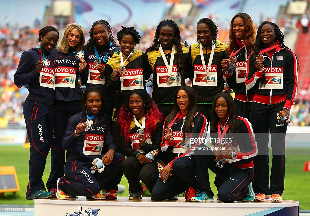 Silver medalists team France, gold medalists team Jamaica and bronze medalists pose on the podium during the medal ceremony for the Women's 4x100 metres final during Day Nine of the 14th IAAF World Athletics Championships Moscow 2013 at Luzhniki Stadium on August 18, 2013 in Moscow, Russia.