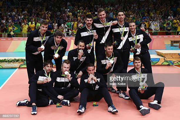 Silver medalists team Italy celebrate during the medal ceremony during the Men's Gold Medal Match between Italy and Brazil on Day 16 of the Rio 2016...