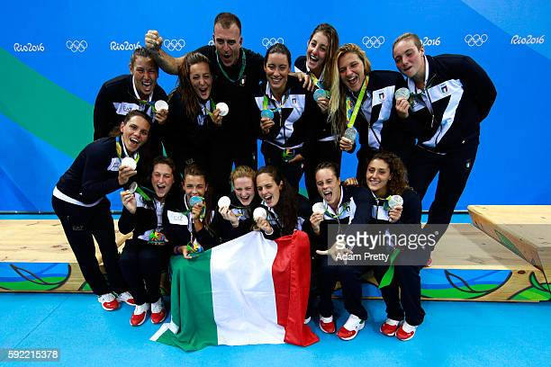 Silver medalists Team Italy celebrate on the podium during the medal ceremony for the Women's Water Polo Gold Medal match between the United States...