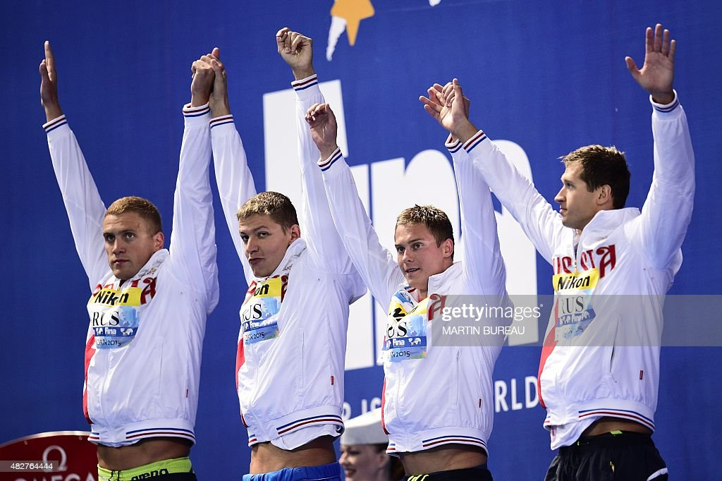 Silver medalists, Team Russia, <a gi-track='captionPersonalityLinkClicked' href=/galleries/search?phrase=Alexander+Sukhorukov&family=editorial&specificpeople=5128396 ng-click='$event.stopPropagation()'>Alexander Sukhorukov</a>, <a gi-track='captionPersonalityLinkClicked' href=/galleries/search?phrase=Vladimir+Morozov&family=editorial&specificpeople=6614710 ng-click='$event.stopPropagation()'>Vladimir Morozov</a>, <a gi-track='captionPersonalityLinkClicked' href=/galleries/search?phrase=Nikita+Lobintsev&family=editorial&specificpeople=964006 ng-click='$event.stopPropagation()'>Nikita Lobintsev</a> and <a gi-track='captionPersonalityLinkClicked' href=/galleries/search?phrase=Andrey+Grechin&family=editorial&specificpeople=6022462 ng-click='$event.stopPropagation()'>Andrey Grechin</a> pose during the podium ceremony of the men's 4x100m freestyle relay swimming event at the 2015 FINA World Championships in Kazan on August 2, 2015. AFP PHOTO / MARTIN BUREAU
