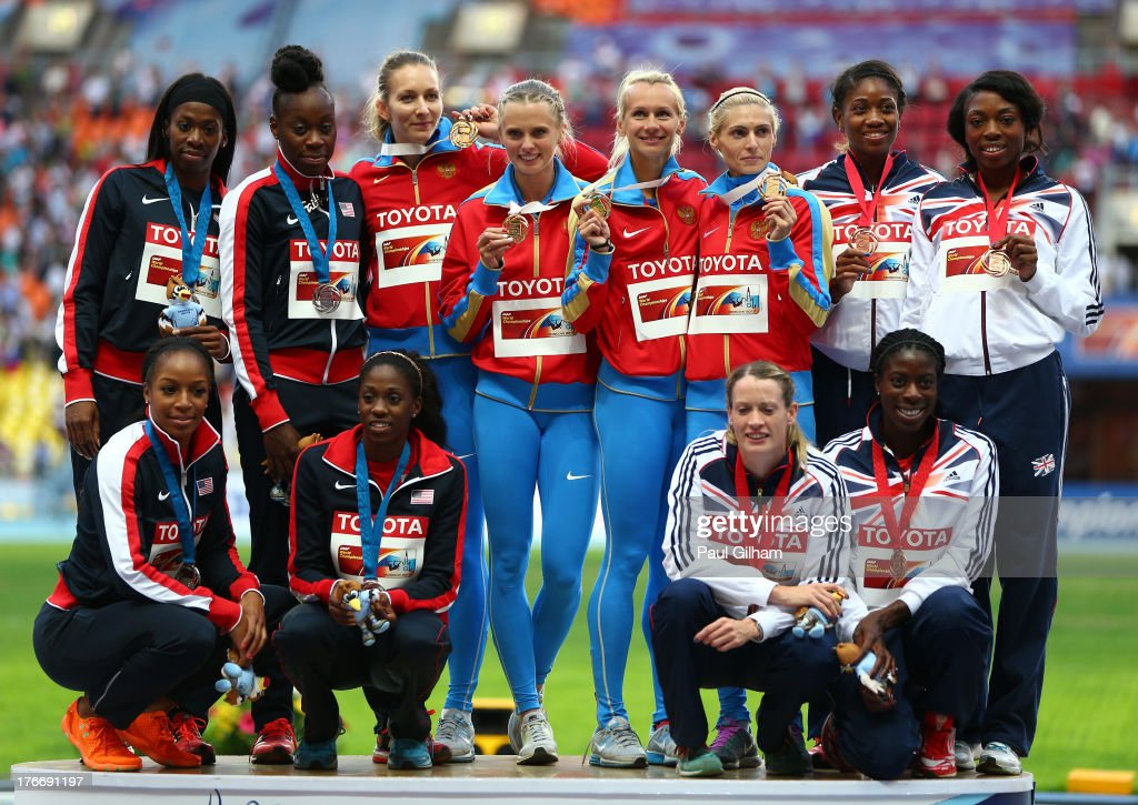 Silver medalists Team United States, Gold medalists team Russia and bronze medalist team Great Britain stand on the podium during the medal ceremony for the Women's 4x400 metres Relay during Day Eight of the 14th IAAF World Athletics Championships Moscow 2013 at Luzhniki Stadium on August 17, 2013 in Moscow, Russia.