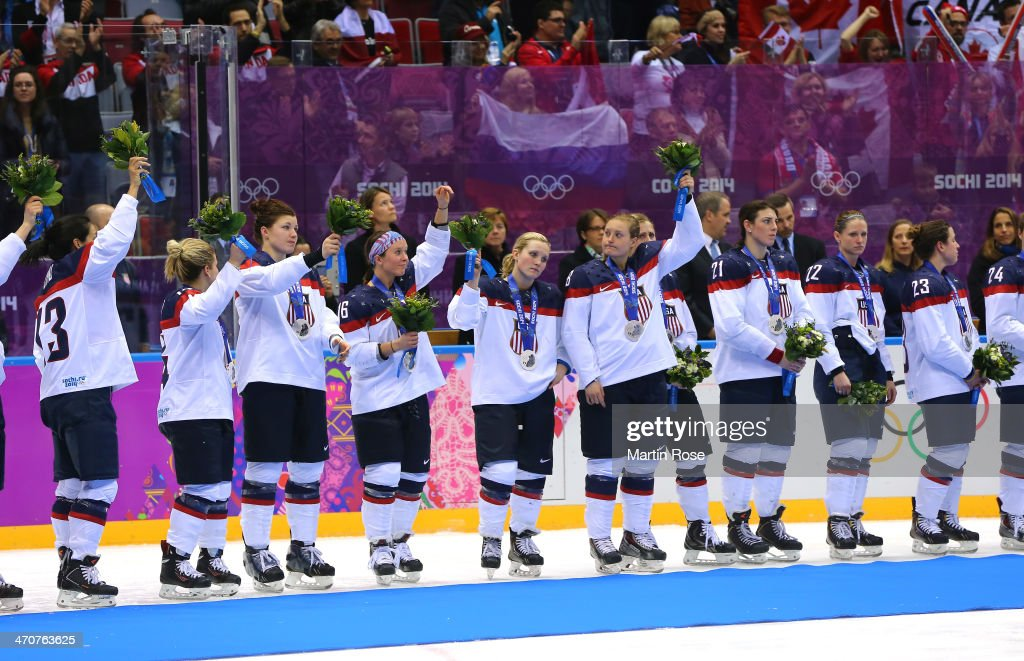 Silver medalists the United States react during the flower ceremony for the Ice Hockey Women's Gold Medal Game on day 13 of the Sochi 2014 Winter Olympics at Bolshoy Ice Dome on February 20, 2014 in Sochi, Russia.