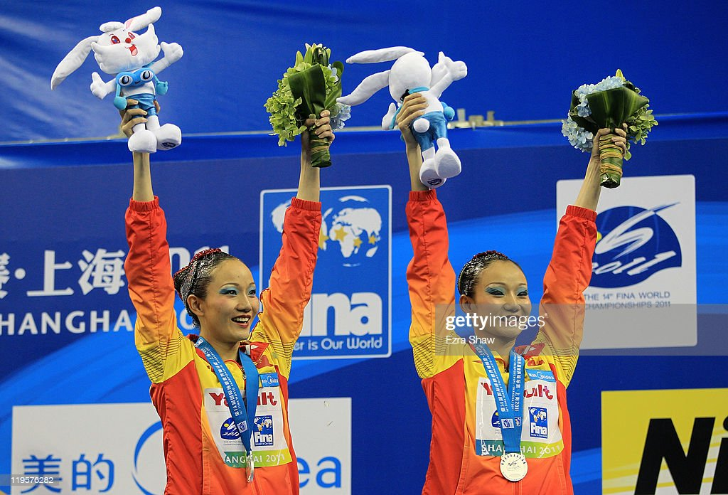 Silver medalists <a gi-track='captionPersonalityLinkClicked' href=/galleries/search?phrase=Tingting+Jiang&family=editorial&specificpeople=4195857 ng-click='$event.stopPropagation()'>Tingting Jiang</a> and <a gi-track='captionPersonalityLinkClicked' href=/galleries/search?phrase=Wenwen+Jiang&family=editorial&specificpeople=4195858 ng-click='$event.stopPropagation()'>Wenwen Jiang</a> of China attend the victory ceremony for the Synchronized Swimming Duet Free during Day Seven of the 14th FINA World Championships at the Oriental Sports Center on July 22, 2011 in Shanghai, China. Natalia Ishchenko and Svetlana Romashina of Russia won gold and Ona Carbonell and Andrea Fuentes of Spain won bronze.