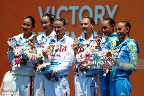 Silver medalists Tingting Jiang and Wenwen Jiang of China gold medalists Svetlana Kolesnichenko and Alexandra Patskevich of Russia and bronze...
