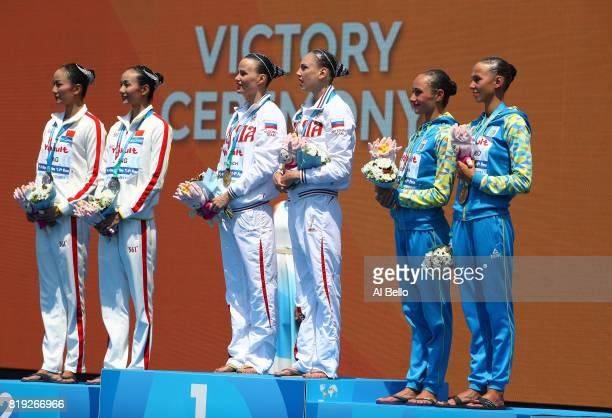 Silver medalists Tingting Jiang and Wenwen Jiang of China gold medalists Svetlana Kolesnichenko and Alexandra Patskevich of Russia and bronze...