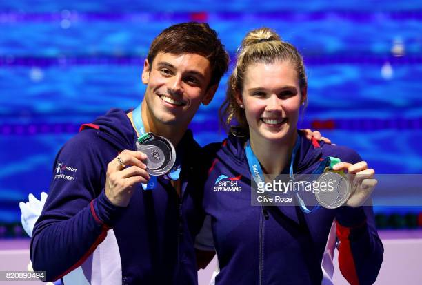 Silver medalists Tom Daley and Grace Reid of Great Britain pose with the medals won during the Mixed 3M Synchro Springboard finalon day nine of the...