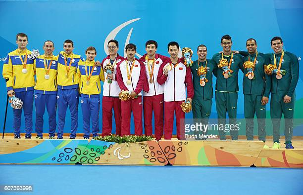 Silver medalists Ukraine gold medalists China and bronze medalists Brazil pose for photographs on the podium at the medal ceremony for the Men's...