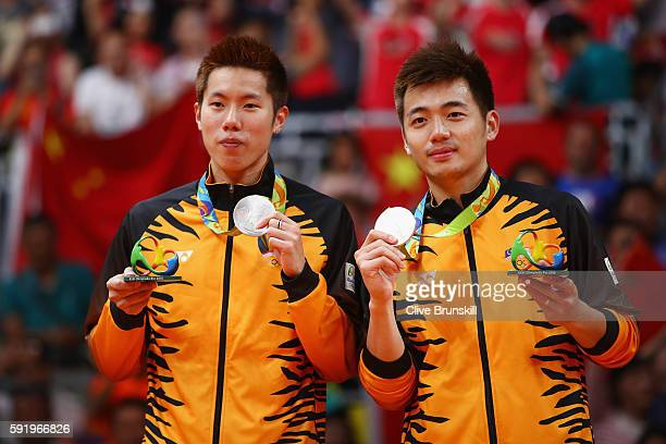 Silver medalists V Shem Goh and Wee Kiong Tan of Malaysia stand on the podium during the medal ceremony after the Men's Badminton Doubles competition...