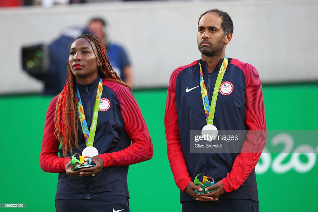Silver medalists Venus Williams and Rajeev Ram of the United States pose on the podium during the ceremony for the mixed doubles on Day 9 of the Rio...