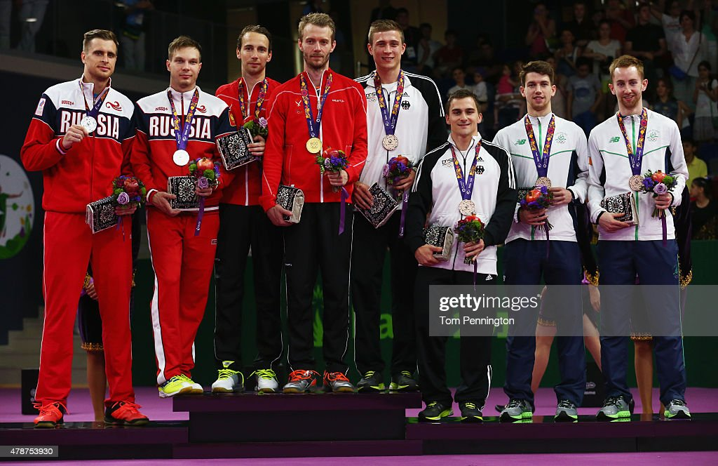 Silver medalists Vladimir Ivanov and <a gi-track='captionPersonalityLinkClicked' href=/galleries/search?phrase=Ivan+Sozonov&family=editorial&specificpeople=7801716 ng-click='$event.stopPropagation()'>Ivan Sozonov</a> of Russia, gold medalists <a gi-track='captionPersonalityLinkClicked' href=/galleries/search?phrase=Mathias+Boe&family=editorial&specificpeople=651077 ng-click='$event.stopPropagation()'>Mathias Boe</a> and <a gi-track='captionPersonalityLinkClicked' href=/galleries/search?phrase=Carsten+Mogensen&family=editorial&specificpeople=651076 ng-click='$event.stopPropagation()'>Carsten Mogensen</a> of Denmark and bronze medalists Raphael Beck and Andreas Heinz of Germany and Joshua Magee and Sam Magee of Ireland stand on the podium during the medal ceremony for the Men's Badminton Doubles on day fifteen of the Baku 2015 European Games at at Baku Sports Hall on June 27, 2015 in Baku, Azerbaijan.