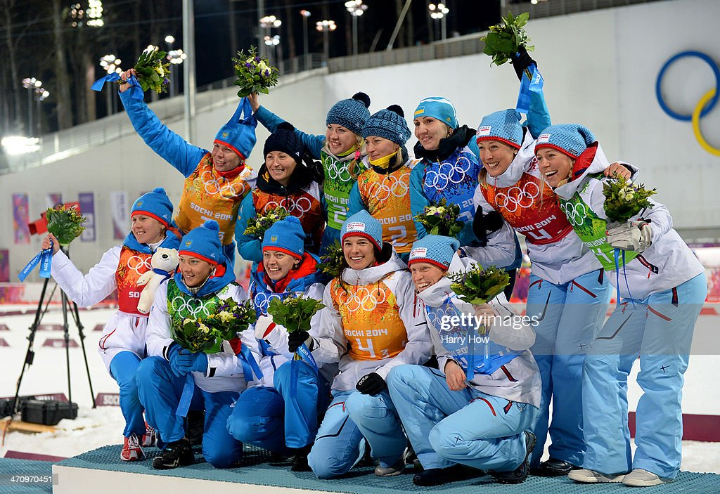 Silver medalists Yana Romanova, <a gi-track='captionPersonalityLinkClicked' href=/galleries/search?phrase=Olga+Zaitseva&family=editorial&specificpeople=723918 ng-click='$event.stopPropagation()'>Olga Zaitseva</a>, Ekaterina Shumilova and <a gi-track='captionPersonalityLinkClicked' href=/galleries/search?phrase=Olga+Vilukhina&family=editorial&specificpeople=7398357 ng-click='$event.stopPropagation()'>Olga Vilukhina</a> of Russia, gold medalists <a gi-track='captionPersonalityLinkClicked' href=/galleries/search?phrase=Vita+Semerenko&family=editorial&specificpeople=4894891 ng-click='$event.stopPropagation()'>Vita Semerenko</a>, <a gi-track='captionPersonalityLinkClicked' href=/galleries/search?phrase=Juliya+Dzhyma&family=editorial&specificpeople=10101687 ng-click='$event.stopPropagation()'>Juliya Dzhyma</a>, Valj Semerenko and <a gi-track='captionPersonalityLinkClicked' href=/galleries/search?phrase=Olena+Pidhrushna&family=editorial&specificpeople=6567208 ng-click='$event.stopPropagation()'>Olena Pidhrushna</a> of Ukraine and bronze medalists Fanny Welle-Strand Horn, <a gi-track='captionPersonalityLinkClicked' href=/galleries/search?phrase=Tiril+Eckhoff&family=editorial&specificpeople=10023336 ng-click='$event.stopPropagation()'>Tiril Eckhoff</a>, Ann Kristin Aafedt Flatland and <a gi-track='captionPersonalityLinkClicked' href=/galleries/search?phrase=Tora+Berger&family=editorial&specificpeople=812729 ng-click='$event.stopPropagation()'>Tora Berger</a> of Norway celebrate on the podium during the flower ceremony for the the Biathlon Women's 4 x 6 km Relay during day 14 of the Sochi 2014 Winter Olympics at Laura Cross-country Ski & Biathlon Center on February 21, 2014 in Sochi, Russia.