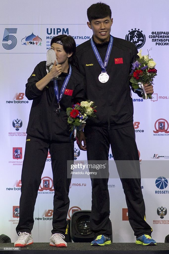 Silver medalists Zhang Xiaonan and Han Jiahao from China during celebration ceremony at the mixed relay World Championship in modern pentathlon in Moscow in Olympic Sports Complex in Moscow, Russia, on May 29, 2016.