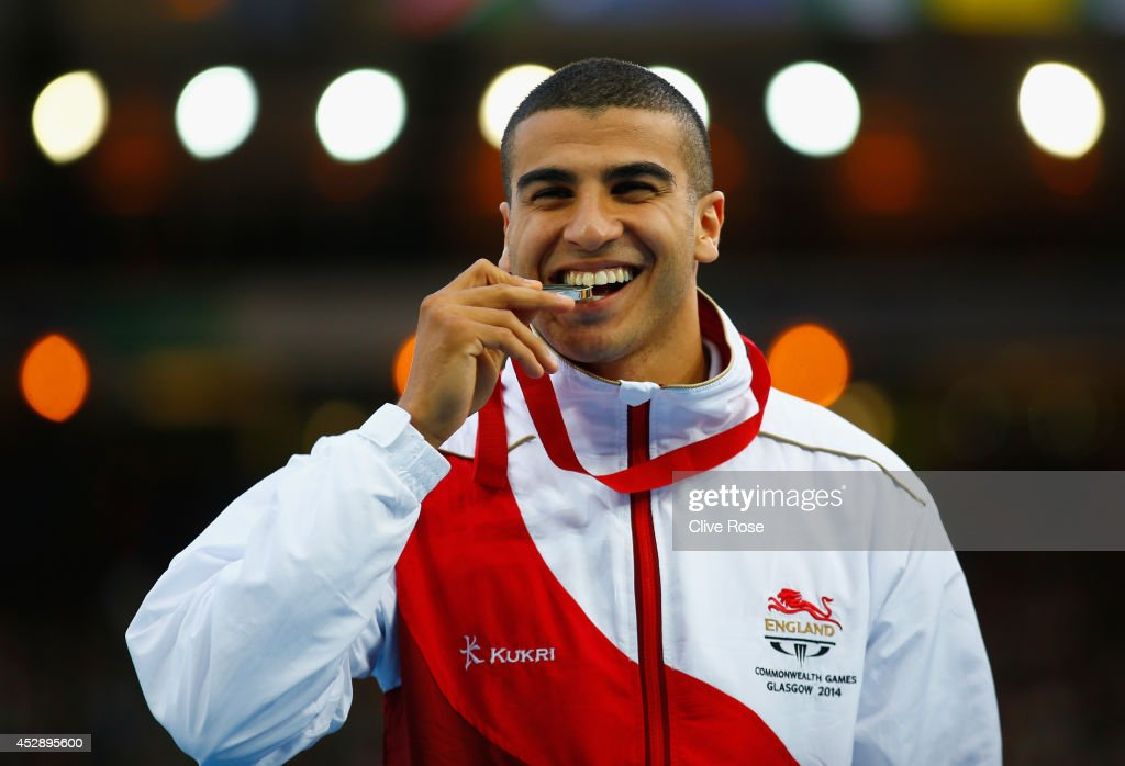 Silver medallist Adam Gemili of England poses on the podium during the medal ceremony for the Men's 100 metres at Hampden Park during day six of the...