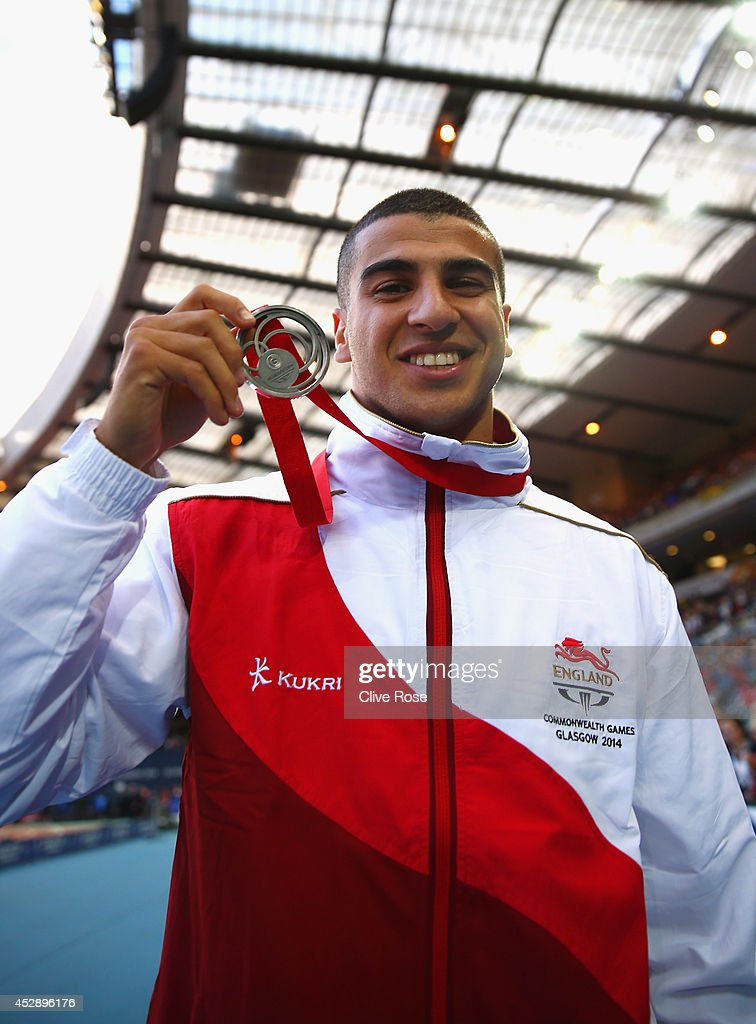 Silver medallist Adam Gemili of England poses with his medal during the medal ceremony for the Men's 100 metres at Hampden Park during day six of the...