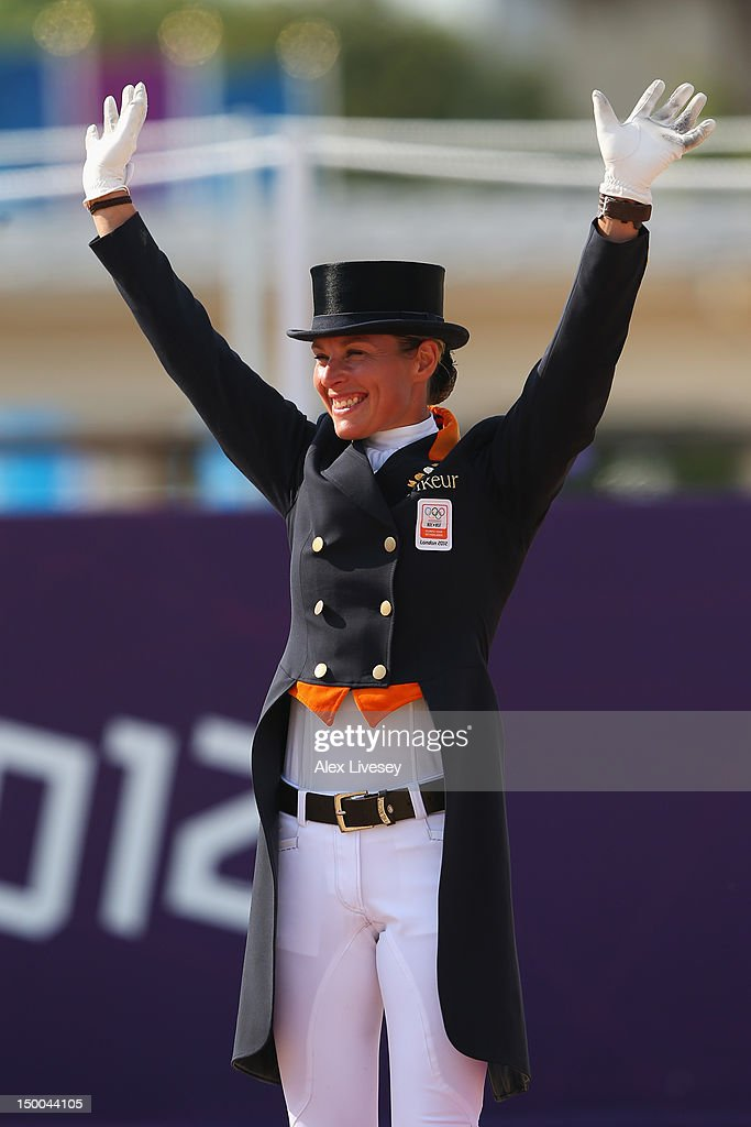 Silver medallist <a gi-track='captionPersonalityLinkClicked' href=/galleries/search?phrase=Adelinde+Cornelissen&family=editorial&specificpeople=5427385 ng-click='$event.stopPropagation()'>Adelinde Cornelissen</a> of Netherlands riding Parzival celebrates during the medal ceremony following the Individual Dressage on Day 13 of the London 2012 Olympic Games at Greenwich Park on August 9, 2012 in London, England.