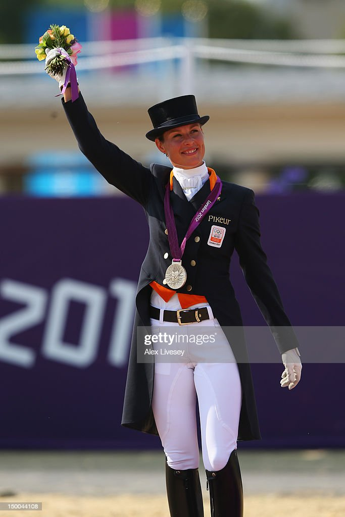 Silver medallist <a gi-track='captionPersonalityLinkClicked' href=/galleries/search?phrase=Adelinde+Cornelissen&family=editorial&specificpeople=5427385 ng-click='$event.stopPropagation()'>Adelinde Cornelissen</a> of Netherlands riding Parzival celebrates with her medal during the medal ceremony following the Individual Dressage on Day 13 of the London 2012 Olympic Games at Greenwich Park on August 9, 2012 in London, England.