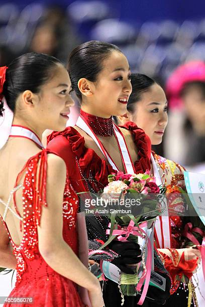 Silver medallist Akiko Suzuki gold medallist Mao Asada and bronze medallist Yukari Nakano pose on the podium at the medal ceremony for the Ladies...