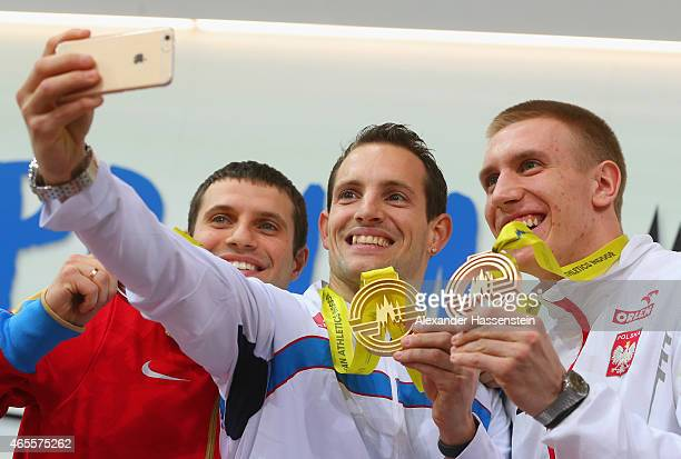 Silver medallist Aleksandr Gripich of Russia gold medallist Renaud Lavillenie of France and bronze medallist Lisek Piotr of Poland pose on the podium...