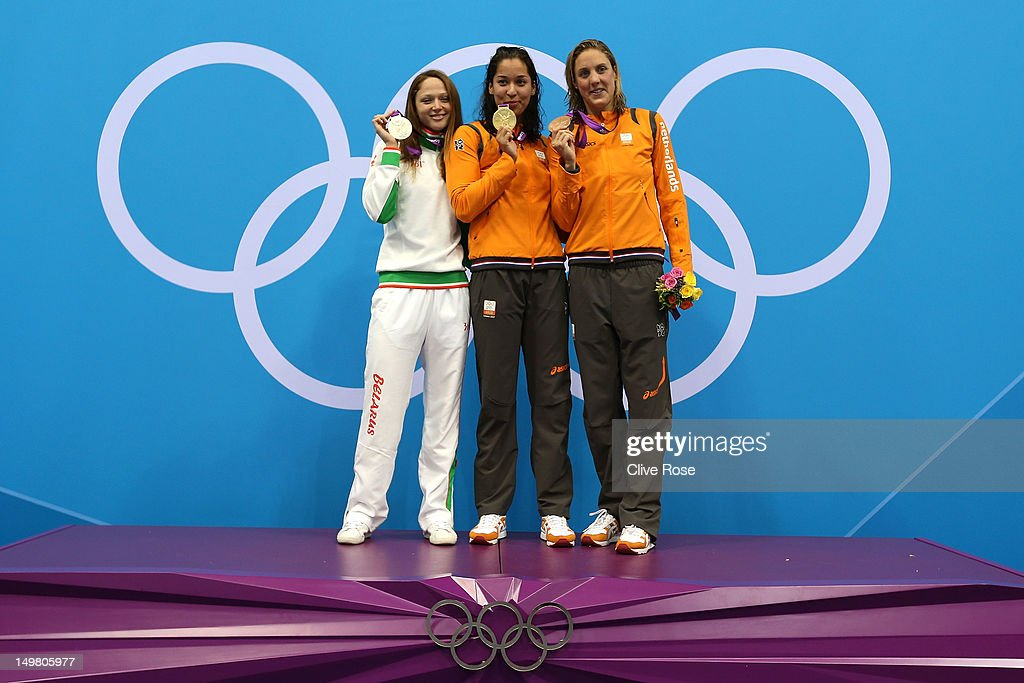 Silver medallist <a gi-track='captionPersonalityLinkClicked' href=/galleries/search?phrase=Aliaksandra+Herasimenia&family=editorial&specificpeople=2077479 ng-click='$event.stopPropagation()'>Aliaksandra Herasimenia</a> of Belarus, gold medallist <a gi-track='captionPersonalityLinkClicked' href=/galleries/search?phrase=Ranomi+Kromowidjojo&family=editorial&specificpeople=4209840 ng-click='$event.stopPropagation()'>Ranomi Kromowidjojo</a> of Netherlands, and bronze medallist Marleen Veldhuis of Netherlands pose on the podium during the medal ceremony Women's 50m Freestyle Final on Day 8 of the London 2012 Olympic Games at the Aquatics Centre on August 4, 2012 in London, England.