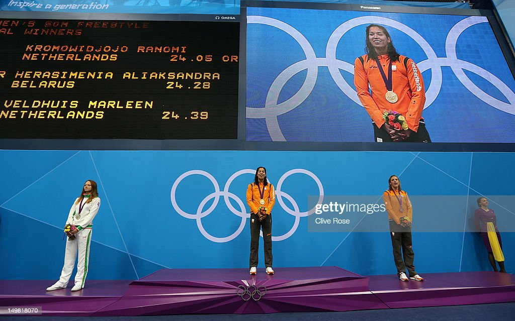 Silver medallist <a gi-track='captionPersonalityLinkClicked' href=/galleries/search?phrase=Aliaksandra+Herasimenia&family=editorial&specificpeople=2077479 ng-click='$event.stopPropagation()'>Aliaksandra Herasimenia</a> of Belarus, gold medallist <a gi-track='captionPersonalityLinkClicked' href=/galleries/search?phrase=Ranomi+Kromowidjojo&family=editorial&specificpeople=4209840 ng-click='$event.stopPropagation()'>Ranomi Kromowidjojo</a> of Netherlands, and bronze medallist <a gi-track='captionPersonalityLinkClicked' href=/galleries/search?phrase=Marleen+Veldhuis&family=editorial&specificpeople=167185 ng-click='$event.stopPropagation()'>Marleen Veldhuis</a> of Netherlands pose on the podium during the medal ceremony Women's 50m Freestyle Final on Day 8 of the London 2012 Olympic Games at the Aquatics Centre on August 4, 2012 in London, England.
