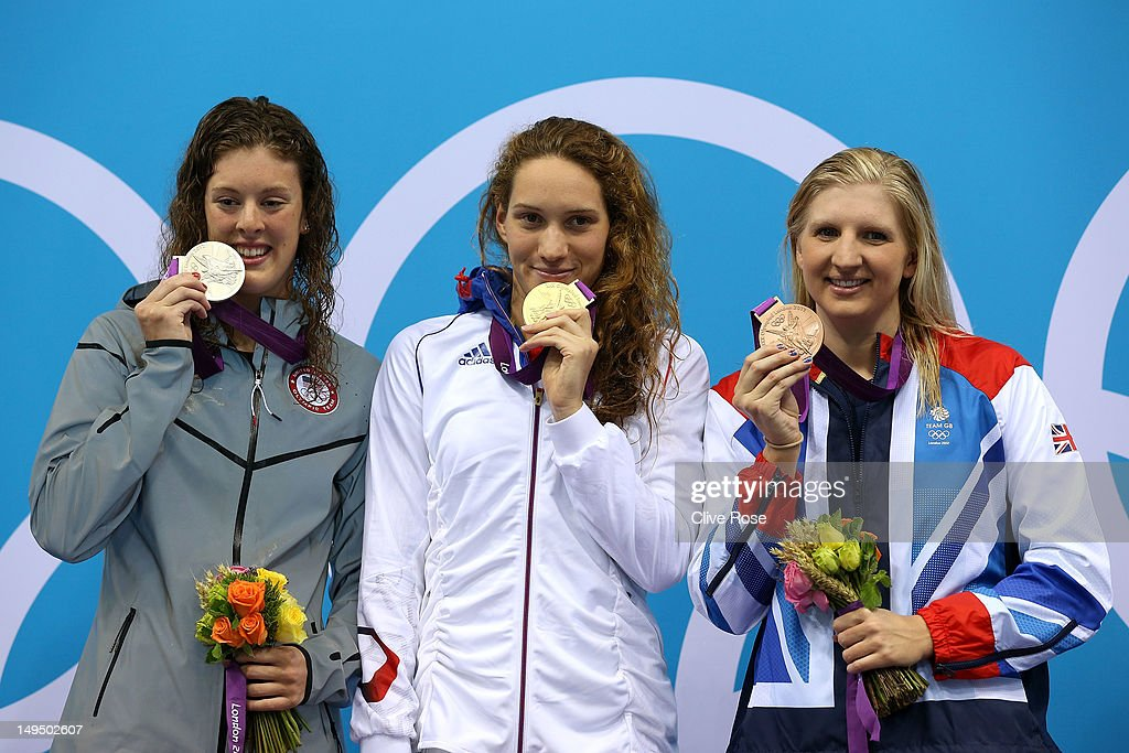 Silver medallist Allison Schmitt of the United States gold medallist Camille Muffat of France and bronze medallist Rebecca Adlington of Great Britain...