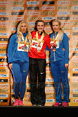 Silver medallist Anastasiya Mokhnyuk of Ukraine gold medallist Brianne Theisen Eaton of Canada and bronze medallist Alina Fodorova of Ukraine pose on...