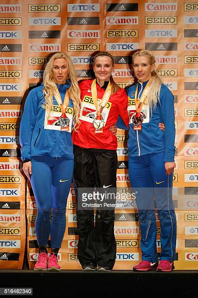 Silver medallist Anastasiya Mokhnyuk of Ukraine gold medallist Brianne Theisen Eaton of Canada and bronze medallist Alina Fodorova of Ukraine pose on...