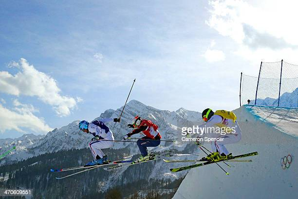 Silver medallist Arnaud Bovolenta of France Brady Leman of Canada and bronze medallist Jonathan Midol of France compete during the Freestyle Skiing...