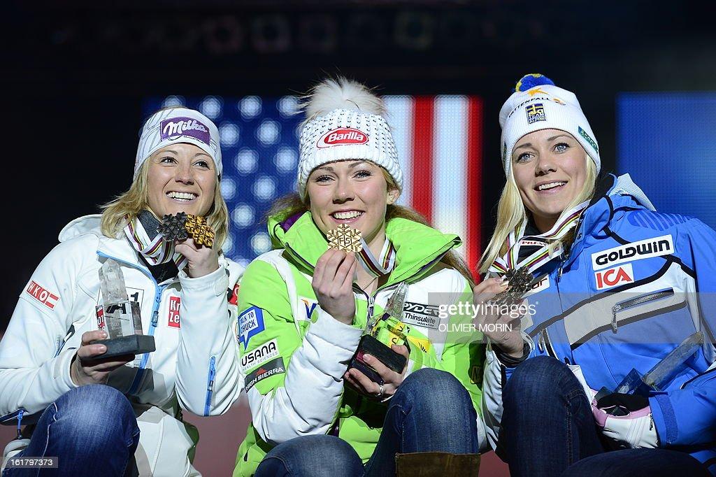 Silver medallist Austria's Michaela Kirchgasser, gold medallist US Mikaela Shiffrin and bronze medallist Sweden's Frida Hansdotter pose during the medal awards ceremony after the women's slalom at the 2013 Ski World Championships in Schladming, Austria on February 16, 2013.