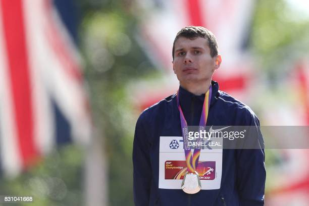 Silver medallist Authorised Neutral Athlete Sergei Shirobokov poses on the podium during the victory ceremony for the men's 20km race walk athletics...