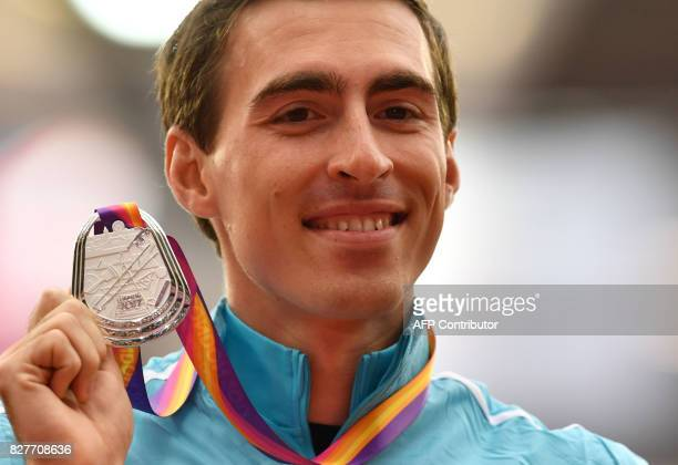 Silver medallist Authorised Neutral Athlete Sergey Shubenkov poses on the podium during the victory ceremony for the men's 110m hurdles athletics...