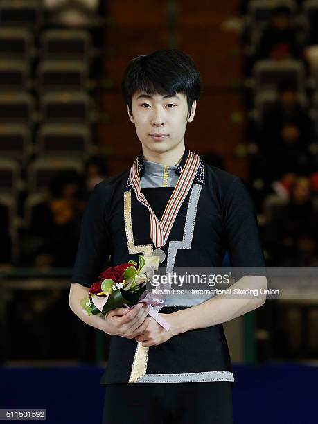 Silver medallist Boyang Jin of China stands on the podium of the Men's Figure Skating on day four of the ISU Four Continents Figure Skating...