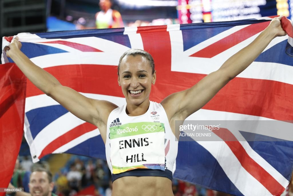 TOPSHOT - Silver medallist Britain's Jessica Ennis-Hill celebrates after the Women's Heptathlon 800M during the athletics event at the Rio 2016 Olympic Games at the Olympic Stadium in Rio de Janeiro on August 13, 2016. / AFP / Adrian DENNIS