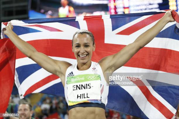 TOPSHOT Silver medallist Britain's Jessica EnnisHill celebrates after the Women's Heptathlon 800M during the athletics event at the Rio 2016 Olympic...